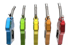 Multiple gasoline types. 3D illustration of five petrol pump isolated on a white background. Each pump is rotated slightly from the middle one that is golden royalty free illustration