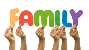 Multiple hands holding the word family Stock Photos