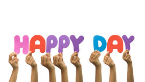 Multiple hands holding the word happy day Stock Photography