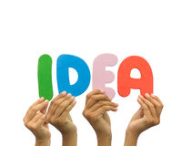Multiple hands holding the word Idea Royalty Free Stock Image
