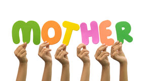 Multiple hands holding the word mother Royalty Free Stock Photo