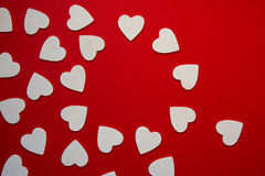 Multiple hearts whites shapes, forming a circular frame, red bac Stock Photography