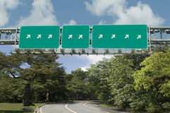 Multiple highway signs pointing in same direction stock image