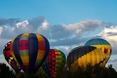 Multiple hot air balloons flying stock photos