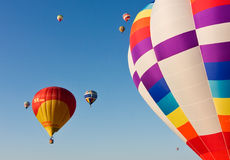 Multiple hot air balloons lift off Royalty Free Stock Image