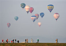 Multiple hot air balloons lift off Stock Photography