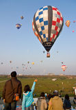 Multiple hot air balloons lift off Royalty Free Stock Photo