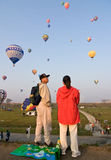 Multiple hot air balloons lift off Royalty Free Stock Photos