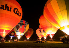 Multiple hot air balloons night glow Stock Photos