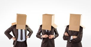 Multiple image of businessmen with cardboard boxes covering head Royalty Free Stock Photo