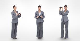 Multiple image of businesswoman holding binoculars Stock Images