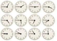 Set of office clocks showing various time isolated on white background royalty free stock photo