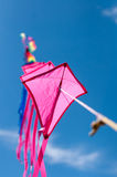 Multiple kites. Kite in a row multiple pink Stock Photo