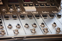Multiple knobs and switches on panel Stock Photos