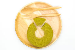 Multiple layers green tea cake on wooden disk Royalty Free Stock Images