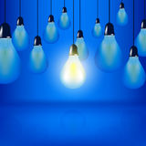 Multiple Light bulbs hanging with cords, one bulb is glowing stock illustration