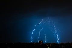 Multiple lightning bolts above Bucharest. Bolts of lightning above Bucharest in a summer night Royalty Free Stock Photo