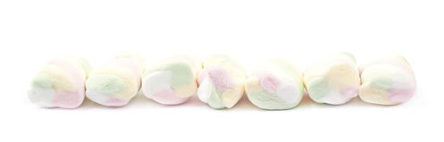 Multiple marshmallows lined up Royalty Free Stock Photo