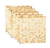 Multiple matza flatbreads lying one over another. Multiple machine made matza flatbreads lying one over another, composition isolated over the white background Royalty Free Stock Photography