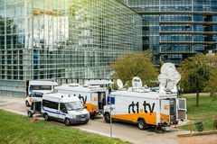 Multiple Media TV Trucks reporting live and police van surveilli Royalty Free Stock Photos