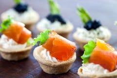 Multiple mini seafood pastry tartlets. Stock Photo