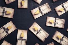Multiple mouse traps with cheese. Mouse traps with cheese pointing towards an empty space Royalty Free Stock Photo