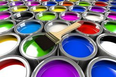Multiple open paint cans with a brush. Stock Photos