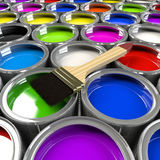 Multiple open paint cans with a brush. Royalty Free Stock Photo