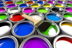 Multiple open paint cans with a brush. Royalty Free Stock Images