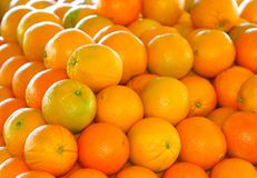 Multiple Oranges. Multiple brightly colored oranges stacked on each other in daylight Royalty Free Stock Photos