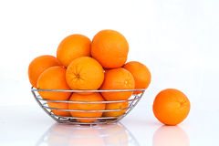 Multiple oranges against a white background. The fruit of the orange tree arranged on a white background Royalty Free Stock Images