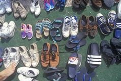 Multiple pairs of shoes on blanket Royalty Free Stock Photography