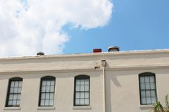 Multiple paned windows along the top of a commercial office building. Horizontal aspect stock image