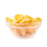 Multiple potato chips in a glass bowl Royalty Free Stock Images