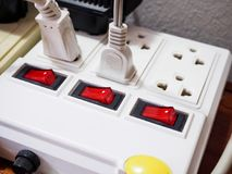 Multiple socket with connected plugs. Multiple power socket with connected plugs royalty free stock image