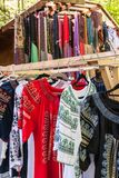 Multiple profile of romanian traditional costumes on hangers shown outdoors.  royalty free stock photography