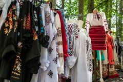 Multiple profile of romanian traditional costumes on mannequins. And hangers shown outdoors Royalty Free Stock Photos