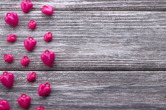 Multiple purple hearts on gray painted rustic white wooden background. Valentine Day. Stock Images