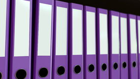 Multiple purple office binders. 3D rendering. Multiple purple office binders. 3D Royalty Free Stock Photography