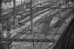 Multiple railway track switches. Industrial view. Transporting system. Symbolic black and white photo for choise. Decision, separation, leadership qualities royalty free stock images