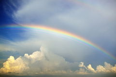 Multiple rainbow in skies Stock Photos