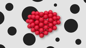 Multiple balloons forming a heart in the center, white background black spots. Multiple red balloons forming a heart and slightly swaying in the air, placed in stock video footage