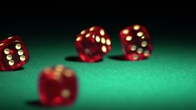 Multiple red dice rolling on green table. Beautiful casino background, gambling. Stock footage stock footage