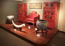 Multiple Red and Gold Japanese Art Pieces at the Belz Museum Stock Image