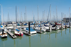 Multiple rows of boats docked in San Francisco on a sunny day Stock Image