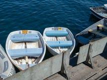 Multiple sailboats docked in a marina area royalty free stock photos