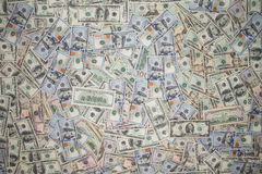 Multiple scattered American 100 dollar banknotes Stock Photos
