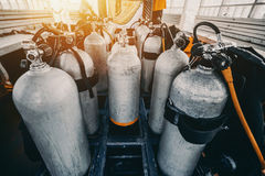 Multiple scuba diving tanks ready for use royalty free stock photography
