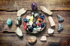 Multiple semi precious gemstones on board Stock Images