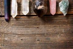 Multiple semi precious gemstones on board. Multiple semi precious gemstones on wooden board Stock Images